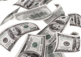 Imagen de varios billetes de cien dólares