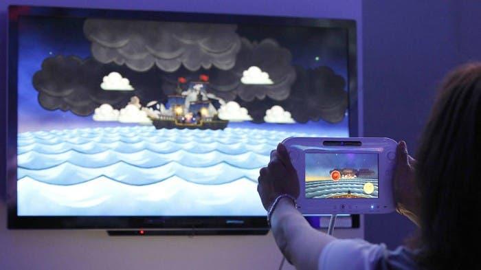 Persona jugando en un expositor de Wii U